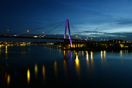 The night lights of the city, harbor, and bridge (Stavanger bybru) in Stavanger, Norway.