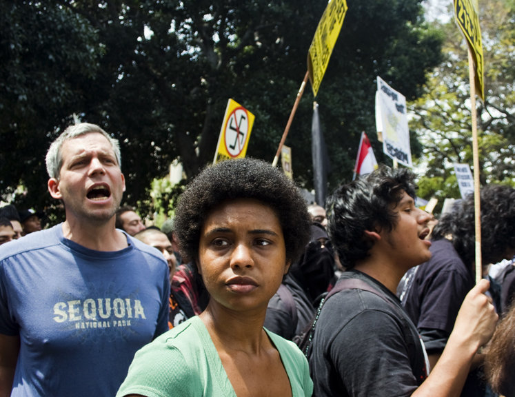 A woman stands among hundreds of protesters who oppose the rally being held by about 40 white supremacists from the National Socialist Movement demonstrated in front of Los Angeles City Hall on April 17.