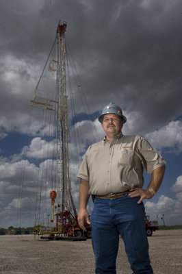 John Crisp, President of Forbes Energy Services, stands tall with an oil servicing rig in the background.  Forbes Energy Services operates one of the youngest and most modern fleet of well service rigs among the large well-servicing companies.  Forbes Energy Services is based in Alice, TX.
