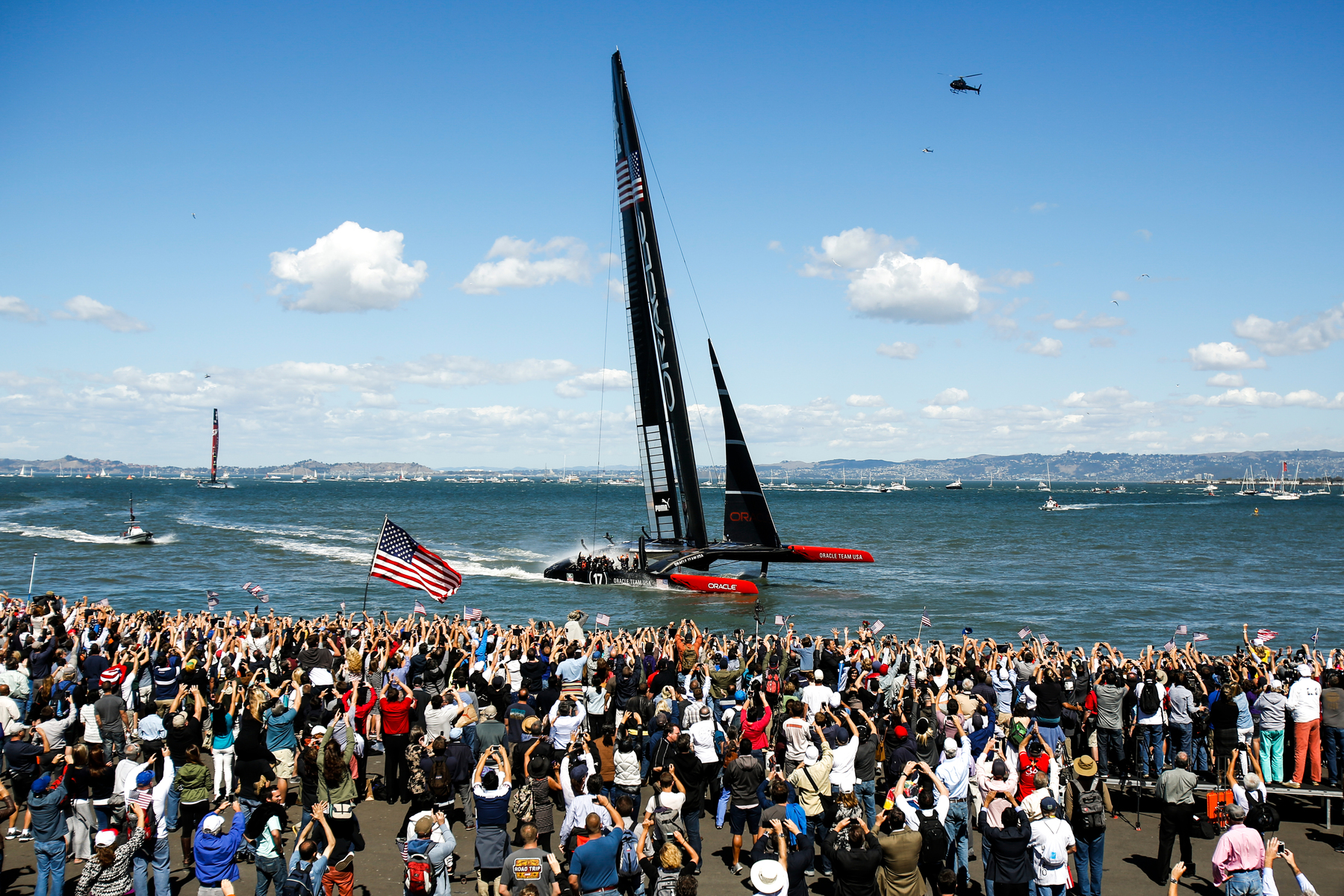Oracle Team USA crosses the finish line after winning Race 19 and the overall title of the 34th America's Cup yacht sailing race over Emirates Team New Zealand in San Francisco, California September 25, 2013.