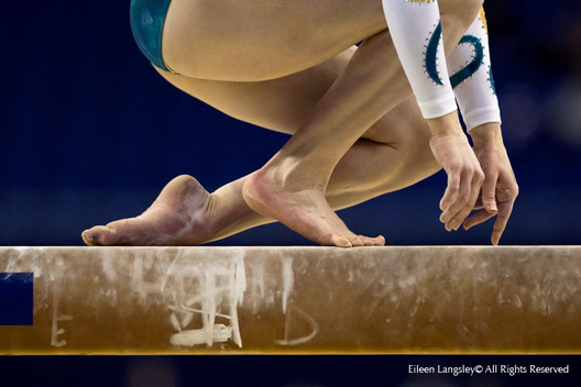 A generic image of the hands and feet of a gymnast competing on the balance beam at the 2009 London World Artistic Gymnastics Championships at the 02 arena.
