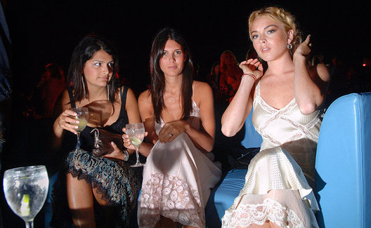 Actress Lindsay Lohan and friends at a charity event in Wainscott, NY that was to benefit Yele Haiti, an organization founded by musician Wyclef Jean to help his native country of Haiti.