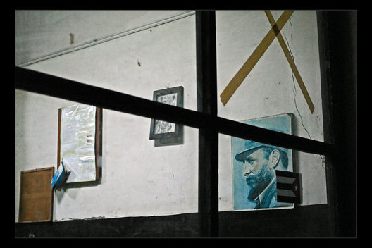 office with Fidel poster, Havana