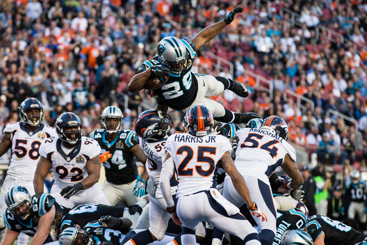 Carolina Panthers' Jonathan Stewart (28) leaps over the goal line to score a touchdown against the Denver Broncos during the NFL's Super Bowl 50 football game in Santa Clara, California California February 7, 2016.