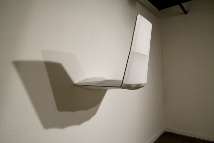 """Winglet"" is installed flush to the gallery wall. Although heavy, it appears very light ; shadows and highlights complete the work.
