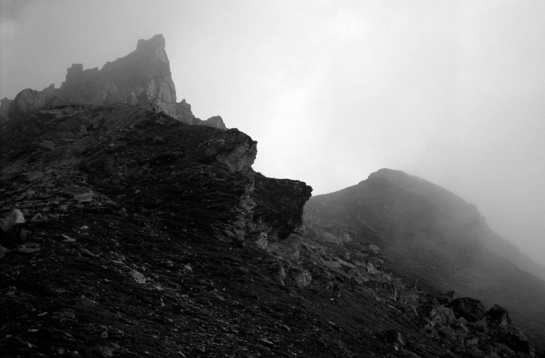 A peak shrouded in morning mist on the Haute Route
