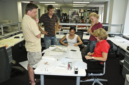 Architecture for Humanity-Minnesota volunteers look over the plans for the new Community Center in Sri Lanka.