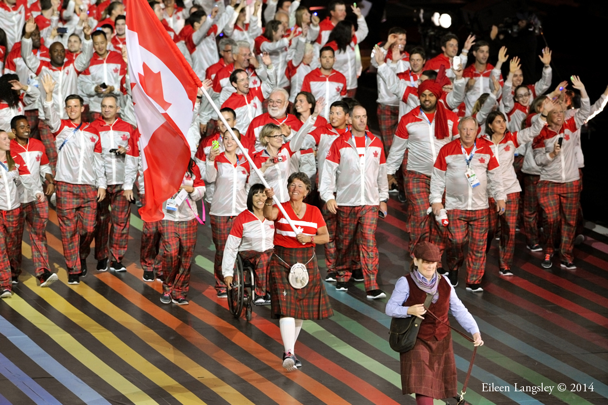 The team from Canada wearing their maple leaf tartan uniforms at the Opening Ceremony of the 2014 Glasgow Commonwealth Games.