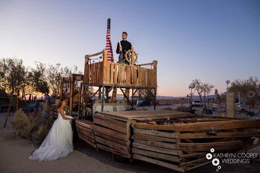 Funny wedding photo on pirate ship with Latino bride and groom in California