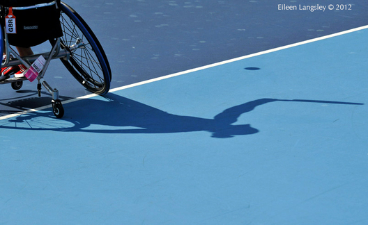 A generic image of the shadow of Lucy Shuker (Great Britain) competing in the women's singles event and Francesc Tur Blanch (Spain) competing in the men's singles of the Wheelchair Tennis competition at the London 2012 Paralympic Games.