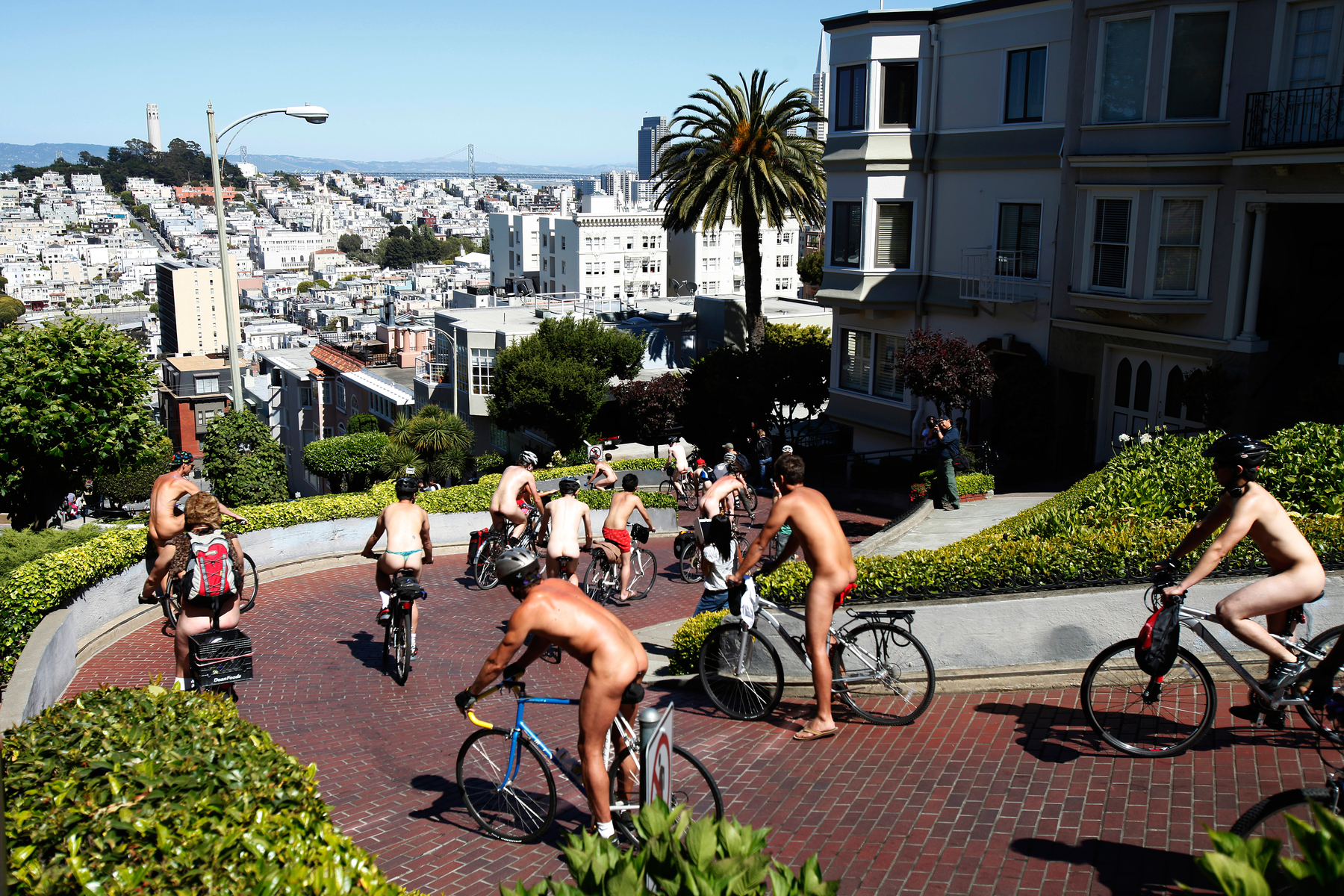 Naked cyclists negotiate the hairpin turns down Lombard Street during the World Naked Bike Ride in downtown San Francisco, California June 9, 2012. The ride aims to promote a body-positive culture and encourage cycling as a greener mode of transportation.