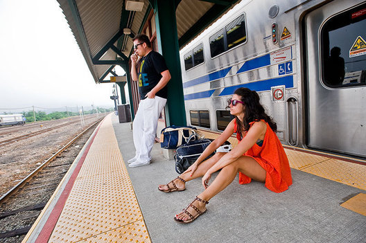 A couple waits for a train Sunday evening after a weekend in Montauk, NY on the Eastern End of Long Island, NY