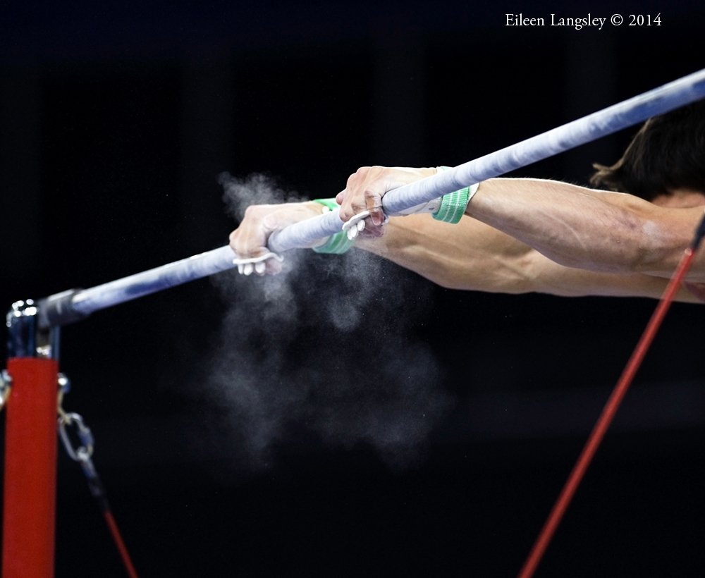 A generic images of the hands of a gymnast competing on High Bar at the 2014 Glasgow Commonwealth Games.