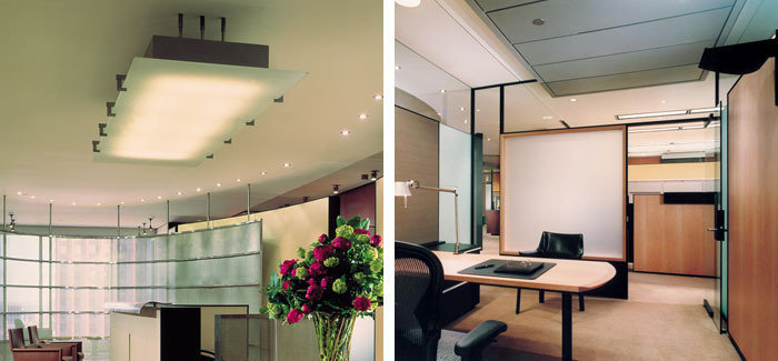 Suspended plate glass reception desk custom pendant. Wall mounted halogen private office uplights
