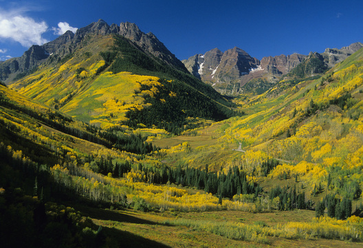 Pyramid Peak, left, and the Maroon Bells, right, near Aspen, Colorado, at the peak of fall.  Michael Brands.