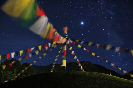 Stars shine above Tibetan prayer flags at the Aspen Institute campus in Aspen, CO.  Michael Brands, 2008