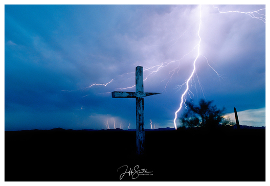 The Tohono O'odham Nation is a touchstone for many. This large 7' cross was captured with a Nikon camera and a 28mm lens. The storm was coming right at at us and the wind was intense. This image is a standout in my collection. 1991