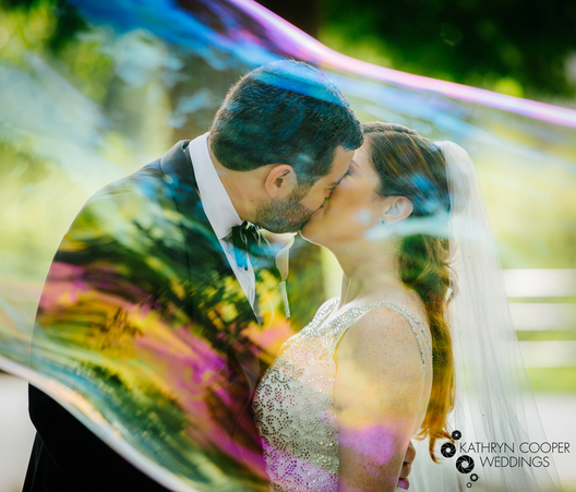 ny elopement photography of couple in giant bubble in Central Park New York City