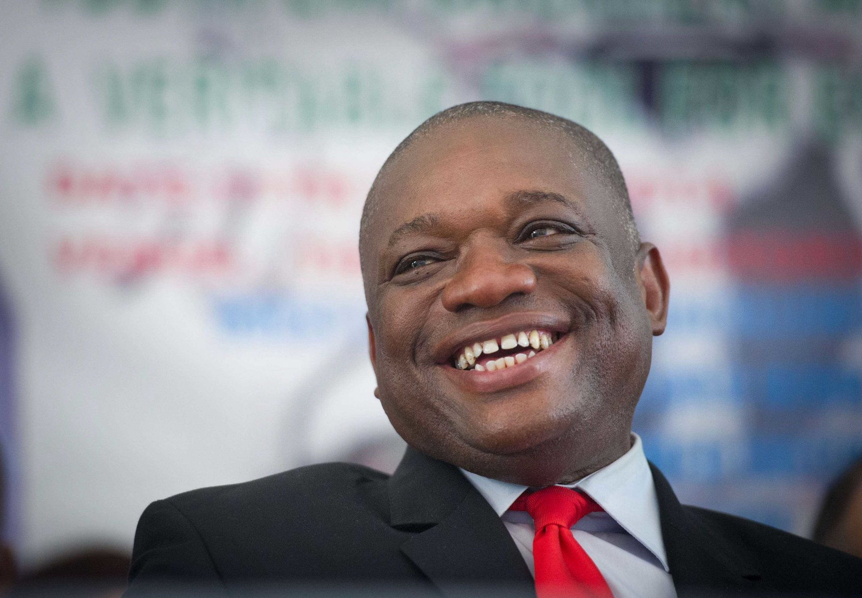 Kalu shares a warm smile while being interviewed at a press converence.
