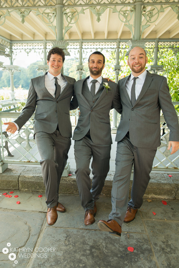 NYC elopement photographer for Central Park elopement with groomsmen dancing in the Ladies Pavilion