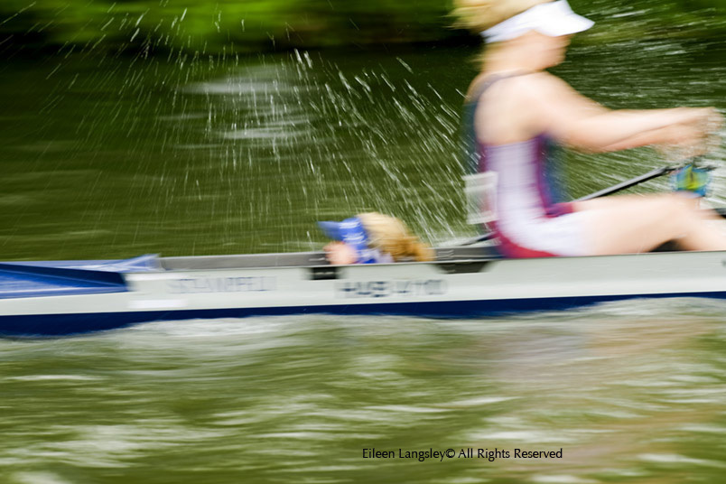A blurred motion action portrait image of a cox getting wet during a race at the 2010 Women's Henley Regatta.