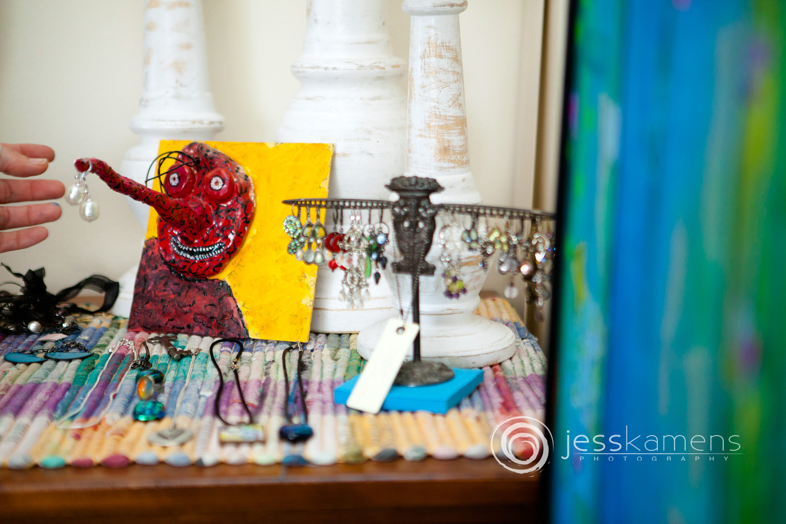 decorations of a handmade jewelry holder with earrings on it
