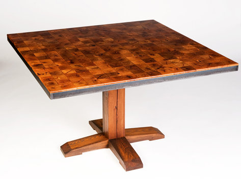 "Dining table with Mesquite till top, waxed steel angle frame and base made of reclaimed long leaf pine. 48"" square and 30"" tall."