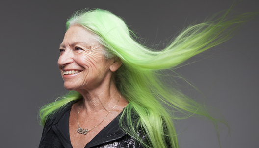"""I started going gray in my 30s, so I did henna. But then I realized everyone was doing henna, so I started using Manic Panic dye. When I found [the bright-green shade of] Electric Lizard, I felt that was my color — I love that it glows in the dark. Everywhere I go, I get compliments on my hair. And you know, it's good when the kids tell you they love it. I feel comfortable at my age, looking as I do. I have fun."""