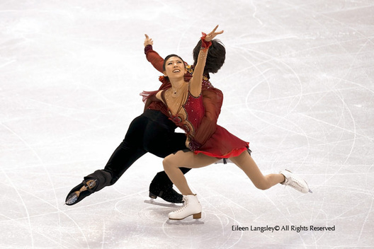 Qin Pang and Jian Tong competing in the Free programme of the Pairs Figure Skating competition at the 2010 Vancouver Winter Olympic Games.