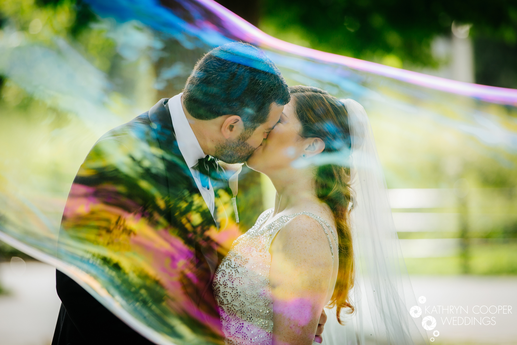 Creative NYC elopement photographer Central park elopement photography of couple in giant bubble