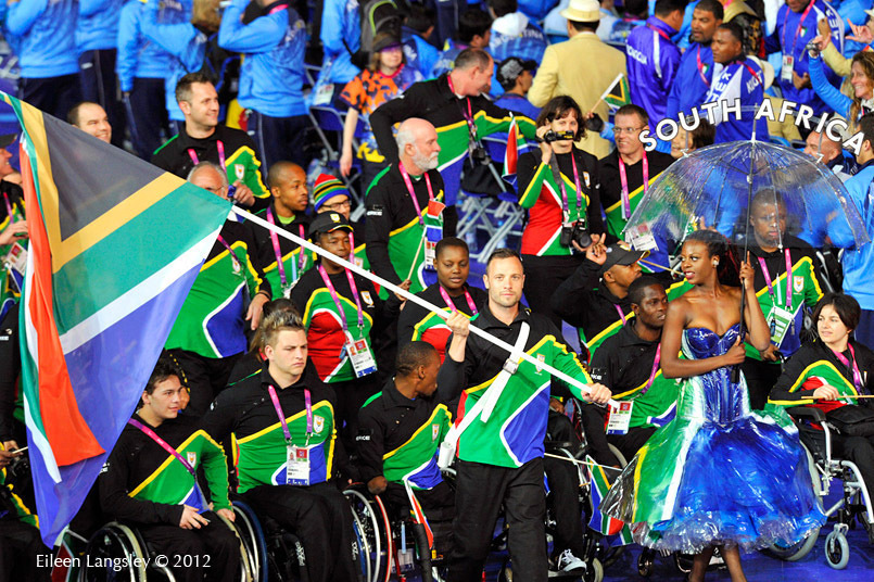 Oscar Pistorius (South Africa) icarries the National flag during the team parade at the Opening Ceremony of the London 2012 Paralympic Games.