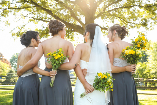 bridesmaids arms around eachother