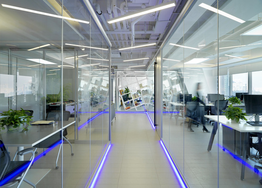 High-tech feel office of MomentCam Office, a Beijing-based mobile app developer, designed by Singapore's office designer, AND lab, in Beijing.