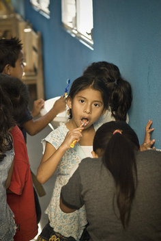 Inside the Mandarin school children are taught hygiene  skills such as brushing their teeth.