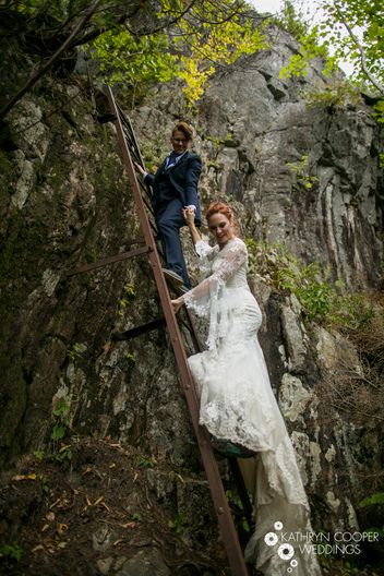 two brides on their destination wedding in acadia nat'l park, hiking and climbing iron ladders in Echo Lake