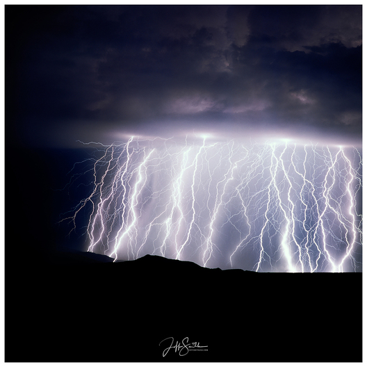 The Rincon mountains, east of Tucson, is notorious for its fierce storms.  This particular evening storm had the most lightning I have ever seen consisting hitting in one place. This image captures all the lighting that incurred in 13 minutes.  1997