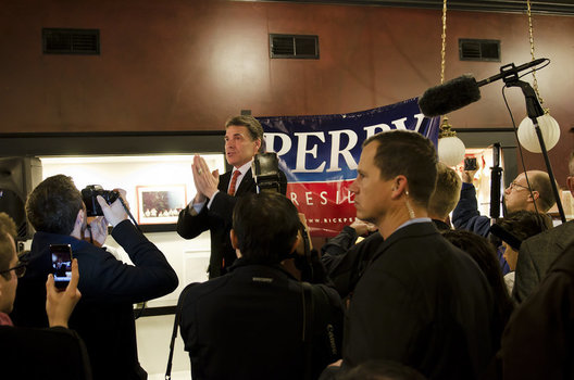 Rick Perry talks at a coffeeshop in Aimes, Iowa on December 11th, 2011.