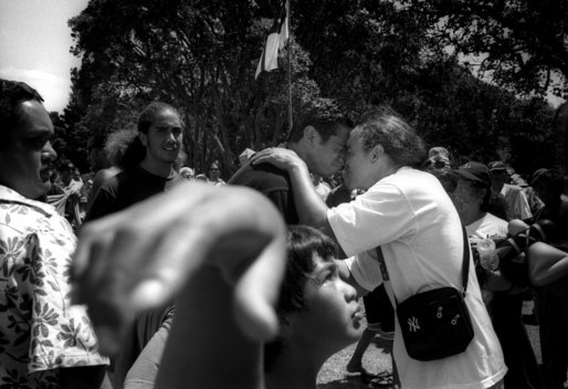 ©Tamara Voninski. Maori men greet each other with a hongi, a traditional greeting pressing noses together ,on Waitangi Day (New Zealand's National Day) in the Bay of Islands in New Zealand.