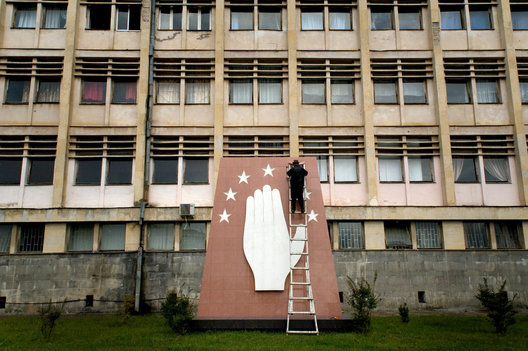 A man repairs a provincial star on the Abkhazian symbol of territory at the Abkhazian State University in Sukhum.