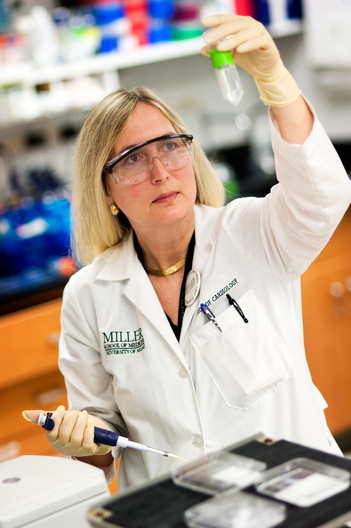 Dr. Nanette Bishopric, cardiac researcher, University of Miami. Dr. Nannette Bishopric, an American College of Cardiology /Merck Adult Cardiology Research Fellow, conducts research in her lab at the Miller School of Medicine at the University of Miami. Photographed for the Merck Company Foundation Brochure.