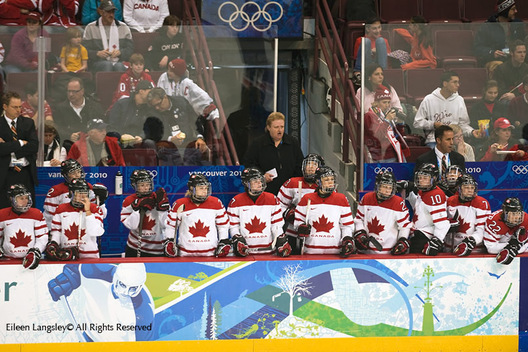 The Canadian women's ice Hockey team look on and support their players out on the ice during their match against Slovakia at the 2010 Winter Olympic Games in Vancouver.