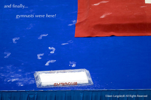 A generic image of the chalky footprints of a gymnast who has moved to compete on the Floor exercise mat.