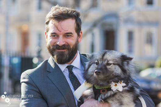 Brooklyn elopement photographer groom with dog in Williamsburg for small wedding