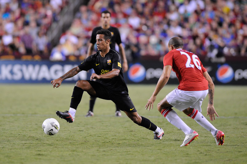 JULY 30 2011: Barcelona Midfielder Thiago Alcantara controls the ball while Manchester United Midfielder Gabriel Oberian gets in position during the Manchester United vs. Barcelona match at Fed Ex Field in Landover, MD.  Manchester United won 2-1.