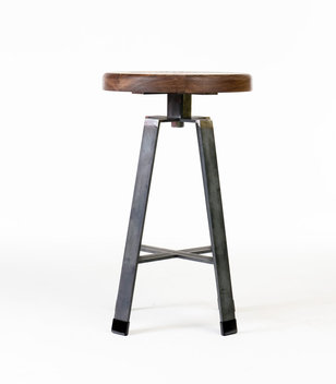 Fixed height stool made from waxed steel bar and walnut top.