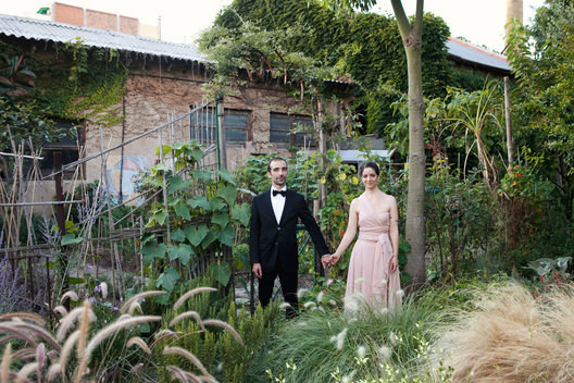 Marta & Fabrizio's eco-conscious, outdoor, non-traditional wedding ceremony and celebration was held at La Cantina de Palo Alto in Barcelona, Spain.