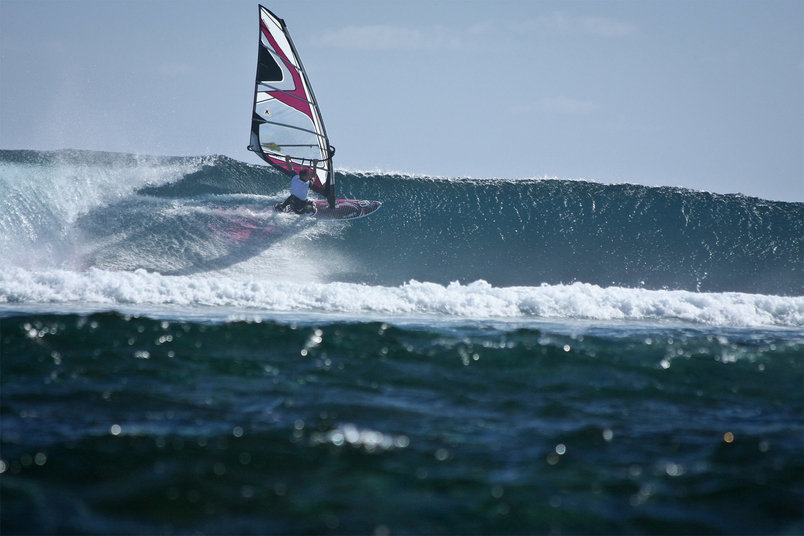 A windsurfer sails Chameaux break at Le Morne, Mauritius.