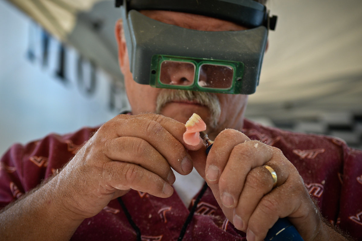 Dentures being shaved for a custom fit.