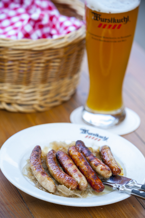 Pork Sausages & sauerkraut at the historic Wurstkuchl, Regensburg, Upper Palatinate, Bavaria, Germany