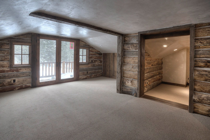 This upper Master Suite was born out of a dark and dirty attic space. The lighting was terrible, so we added a balcony above the garage and amazing mountain views poured in. Lots of space, versitile function.